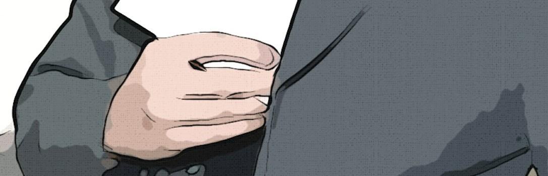 Ein Mann steckt einen Umschlag mit Geld in sein Jackett